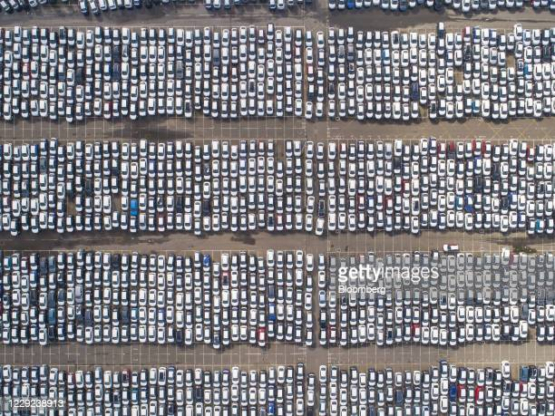 New automobiles in a car park at the Port of Tilbury London Ltd., operated by Forth Ports Ltd., in London, U.K., on Friday, Oct. 23, 2020. Global...