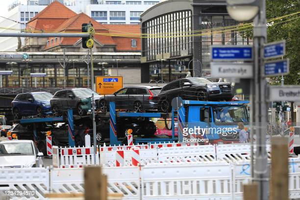New automobiles on a vehicle transport in Berlin, Germany, on Thursday, July 29, 2021. Germany reports gross domestic product figures on July 30....