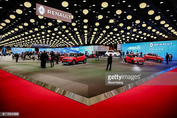 New automobiles sit on the Renault SA stand on the second press day of the Paris Motor Show at Porte de Versailles exhibition center in Paris,...