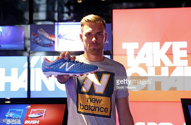 New Balance player Arsenal's Aaron Ramsey attends the launch of the New Balance Visaro and Furon boot at Pro Direct LDN19 on Carnaby Street on July 8...