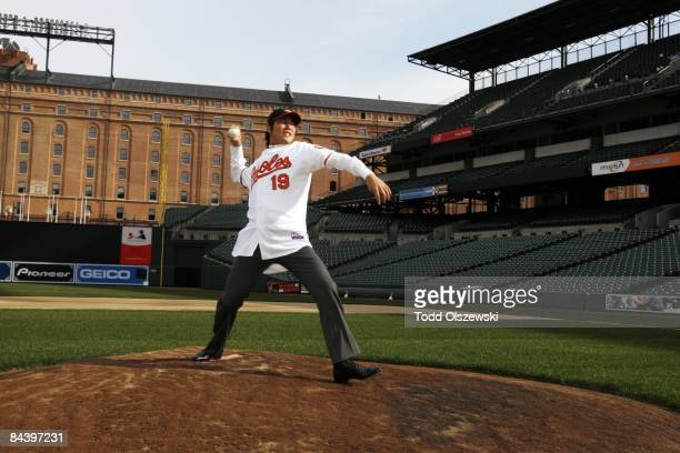 New Baltimore Orioles pitcher Koji Uehara, from Japan, throws a pitch from the pitchers mound at Camden Yards in Baltimore, Maryland after he signed...