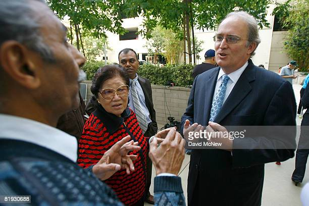 New bank CEO Federal Deposit Insurance Corp executive John Bovenzi tries to reassure customer R Rawal who stands in line with hundreds of other...