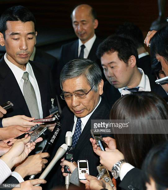 New Bank of Japan Governor Haruhiko Kuroda is surrounded by reporters after his appointment by Prime Minister Shinzo Abe at the latter's office in...