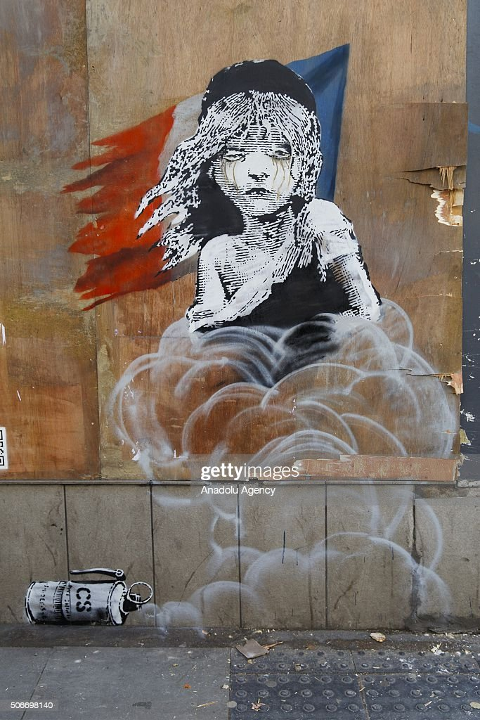 A new Banksy artwork is seen opposite the French embassy in London, United Kingdom on January 25, 2016. The graffiti, which depicts a young girl from the musical Les Miserables with tears in her eyes as tear gas moves towards her, criticises the use of teargas on Refugees.