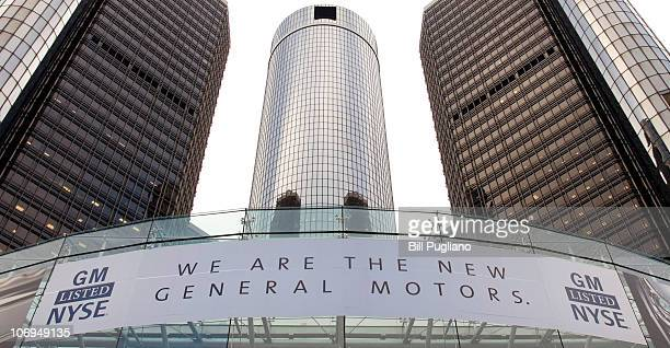 New banner hangs on the front of the General Motors world headquarters complex to proclaim its return to the New York Stock Exchange November 18,...