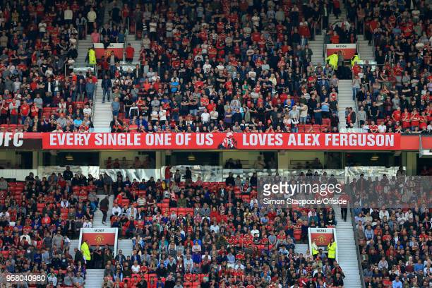 A new banner in the Stretford End reads 'Every Single One Of Us Loves Alex Ferguson' during the Premier League match between Manchester United and...