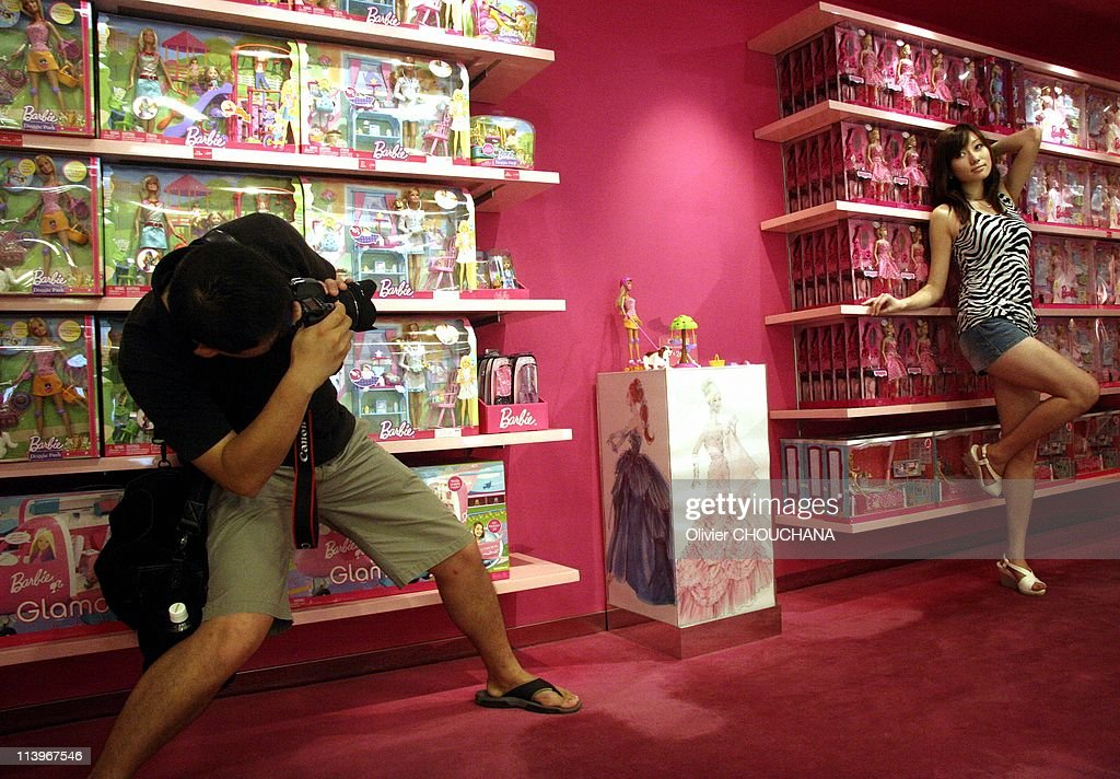 New barbie store in shanghai china on october 01 2009 chinese parents and