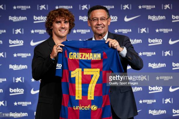 New Barcelona signing Antoine Griezmann and FC Barcelona President Josep Maria Bartomeu poses for the media as he is unveiled at Camp Nou on July 14...
