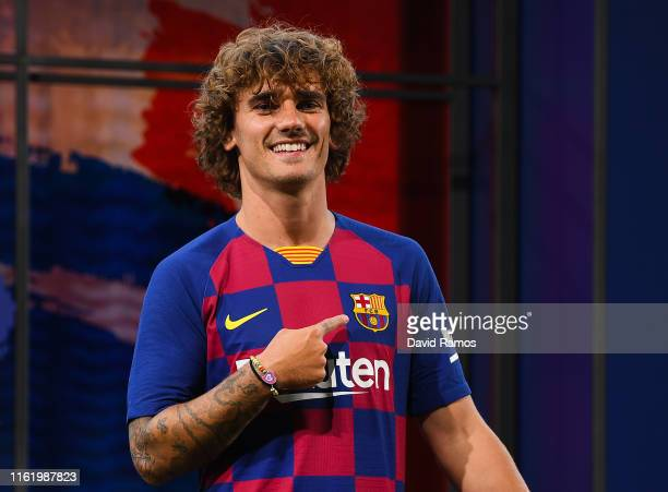 New Barcelona signing Antoine Griezmann poses for the media as he is unveiled at Camp Nou stadium on July 14 2019 in Barcelona Spain
