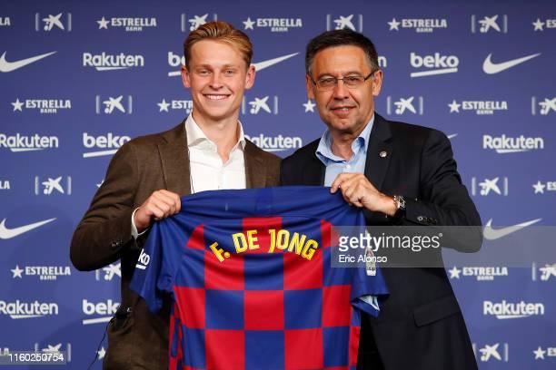 New Barcelona signing Frenkie de Jong and FC Barcelona president Josep Maria Bartomeu pose with the new FC Barcelona shirt as Frenkie de Jong is...