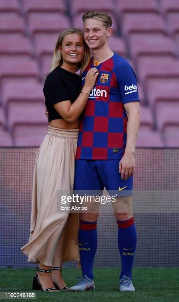 New Barcelona signing Frenkie de Jong and his girlfriend Mikky Kiemeney poses for a picture as he is unveiled at Camp Nou stadium on July 05 2019 in...