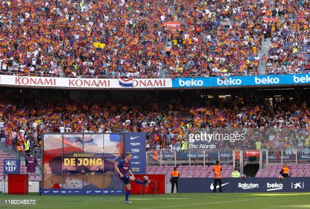 New Barcelona signing Frenkie de Jong juggles the ball as he is unveiled at Camp Nou stadium on July 05 2019 in Barcelona Spain