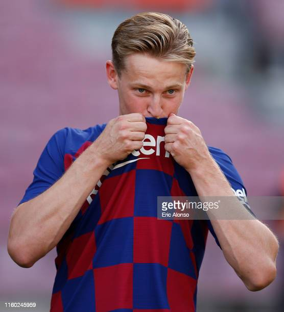 New Barcelona signing Frenkie de Jong kisses the badge as he is unveiled at Camp Nou stadium on July 05 2019 in Barcelona Spain