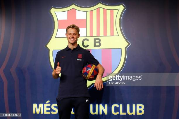 New Barcelona signing Frenkie de Jong poses for the media as he is unveiled at FC Barcelona store on July 04 2019 in Barcelona Spain
