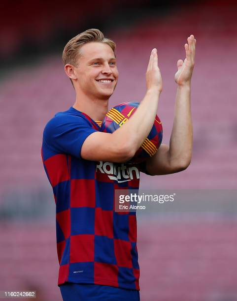 New Barcelona signing Frenkie de Jong waves to fans pitch as he is unveiled at Camp Nou stadium on July 05 2019 in Barcelona Spain