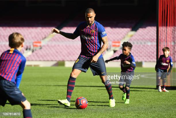New Barcelona signing KevinPrince Boateng enjoys a game with young players as he is unveiled at Nou Camp on January 22 2019 in Barcelona Spain