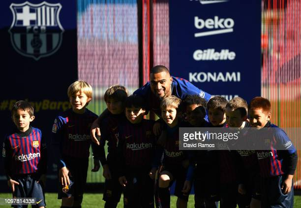 New Barcelona signing KevinPrince Boateng poses with young players as he is unveiled at Nou Camp on January 22 2019 in Barcelona Spain