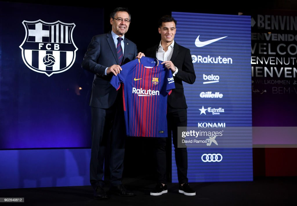 New Barcelona signing Philippe Coutinho (R) and Josep Maria Bartomeu, President of Barcelona (L) pose with his shirt at Camp Nou on January 8, 2018 in Barcelona, Spain. The Brazilian player signed from Liverpool, has agreed a deal with the Catalan club until 2023 season.