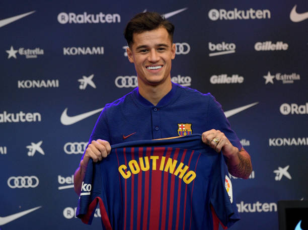 https://media.gettyimages.com/photos/new-barcelona-signing-philippe-coutinho-poses-for-a-photograph-with-picture-id902560806?b=1&k=6&m=902560806&s=612x612&w=0&h=vUF5vdH8sHf2ir3RfXmvnDphGthYaDsYTm7ULptCl4U=