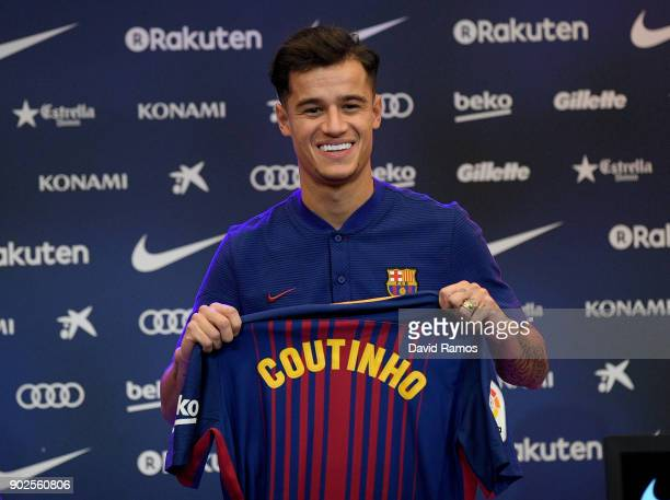New Barcelona signing Philippe Coutinho poses for a photograph with his new shirt as he is unveiled at Camp Nou on January 8 2018 in Barcelona Spain...
