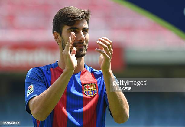 New Barcelona's Portuguesse forward Andre Gomes claps during his official presentation at the Camp Nou stadium in Barcelona on July 27 after signing...