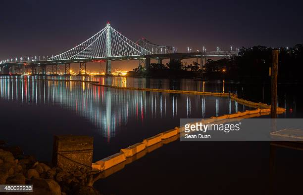new bay bridge at night - new bay bridge stock pictures, royalty-free photos & images