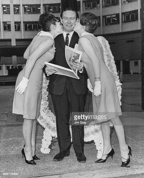 New BBC 2 Program Chief Michael Peacock is kissed on the cheek by girls from Domestic Electric Rentals Jane Brien and Carol Miles outside BBC...