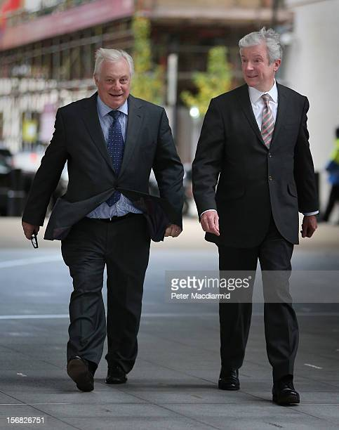 New BBC Director General Lord Hall walks into Broadcasting House with BBC Trust Chairman Lord Patten on November 22 2012 in London England Lord Hall...