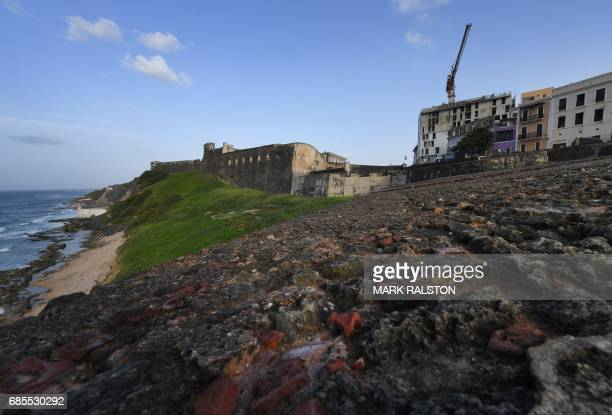 A new beachside hotel under construction beside the El Morro Fortress is pictured on May 15 2017 in San Juan Puerto Rico as the former Spanish colony...