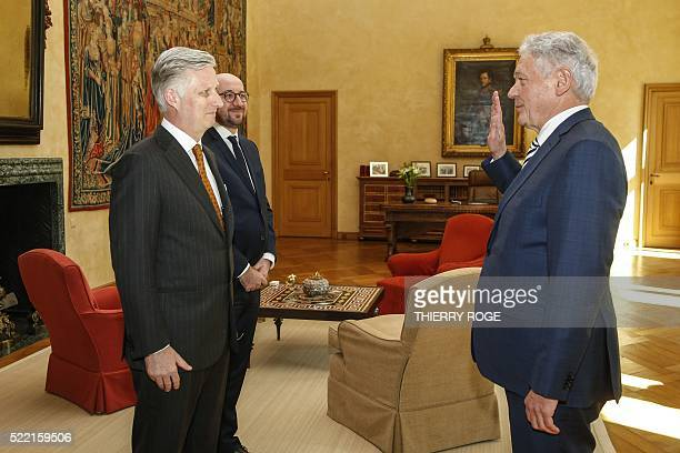 New Belgian Minister of Mobility Francois Bellot gestures in front of King Philippe Filip of Belgium and Belgian Prime Minister Charles Michel during...