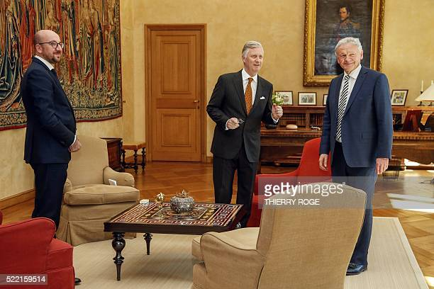 New Belgian Minister of Mobility Francois Bellot stands next to King Philippe Filip of Belgium and Belgian Prime Minister Charles Michel during his...