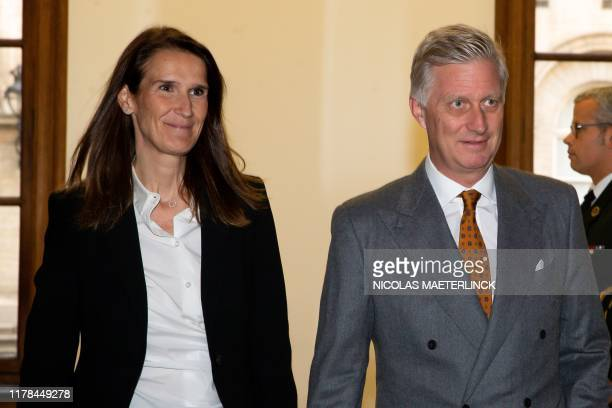 New Belgian Prime Minister Sophie Wilmes and King Philippe Filip of Belgium arrive at the investiture session of the Prime Minister on October 27...