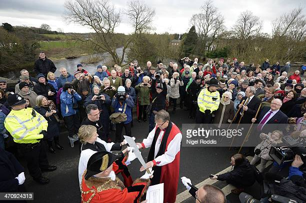 New Bishop of Durham Bishop Paul Butler is presented with a falchion during the traditional welcome to the Diocese on Croft Bridge on February 21...