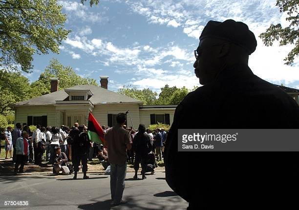 New Black Panther Party member stands guard outside the home where a private dancer alleges she was raped by Duke lacrosse team members during a...