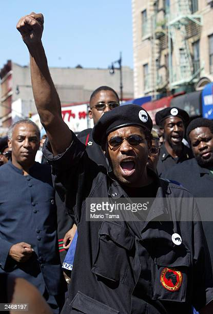 New Black Panther Party member walks in the Miillion Youth March September 6 2003 in the Brooklyn borough of New York City Only hundreds attended the...
