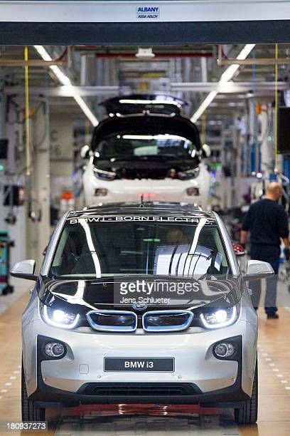 A new BMW i3 electric car is seen on the assembly line at the BMW factory on September 18 2013 in Leipzig Germany The i3 is BMW's first mass market...