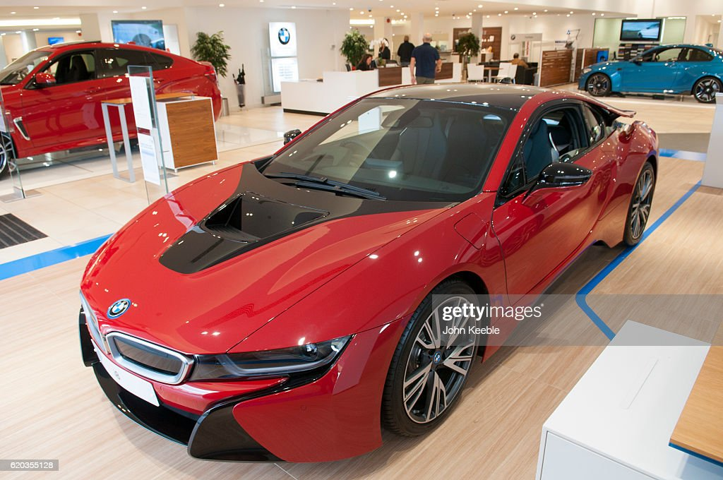 A New BMW I8 Edrive Hybrid Petrol Electric Car In Red And Black Sits In