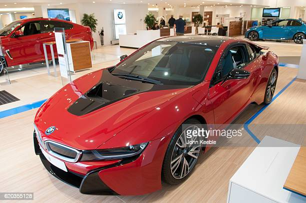 A new BMW i8 Edrive hybrid petrolelectric car in red and black sits in a showroom on October 20 2016 in Southend United Kingdom