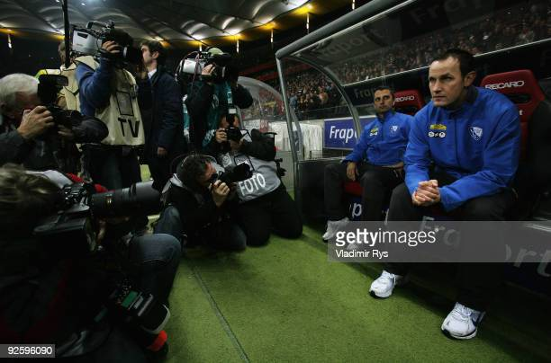 New Bochum head coach Heiko Herrlich sits on the bench ahead of the Bundesliga match between Eintracht Frankfurt and VfL Bochum at Commerzbank Arena...