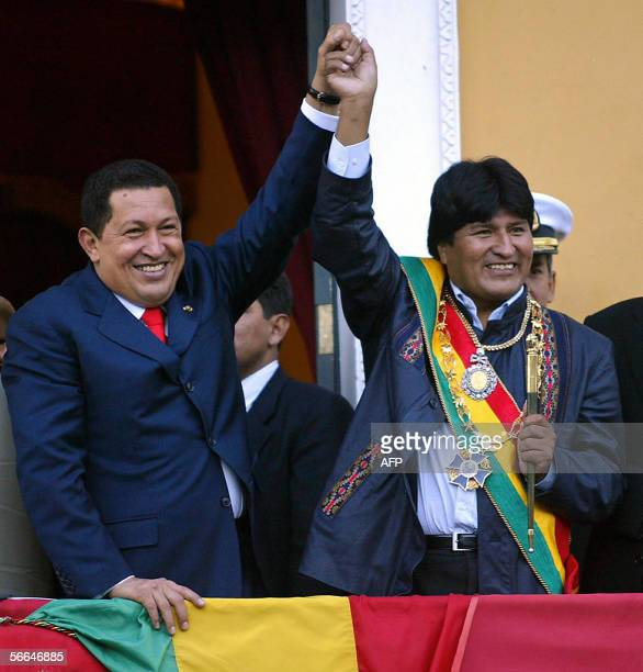 New Bolivian President Evo Morales and his Venezuelan counterpart Hugo Chavez wave from the Quemado Presidential Palace balcony in La Paz, 22...