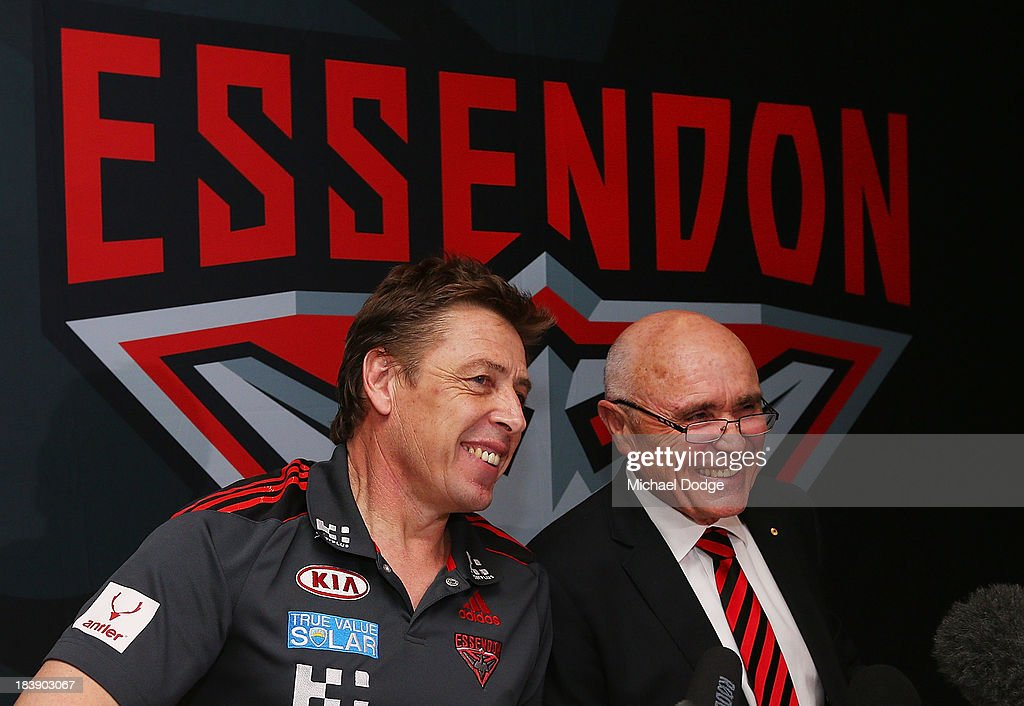 New Bombers coach Mark Thompson (L) and Chairman Paul Little react during an Essendon Bombers AFL press conference at Windy Hill on October 10, 2013 in Melbourne, Australia.