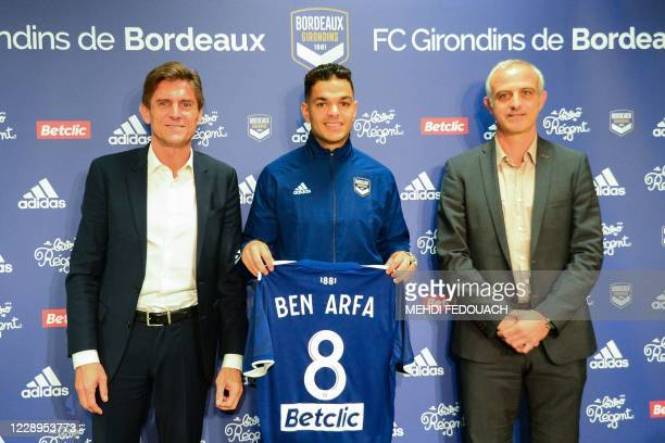 New Bordeaux' French forward Hatem Ben Arfa poses with his new jersey flanked by Bordeaux's president Frédéric Longuepee and Bordeaux' sportive...