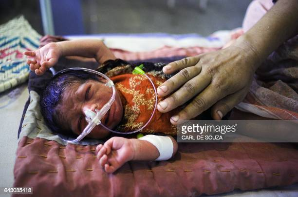 A new born baby diagnosed with gastroenteritis is treated at a hospital near Gehnay Wala Punjab Province Pakistan on September 4 2010 Hospitals have...