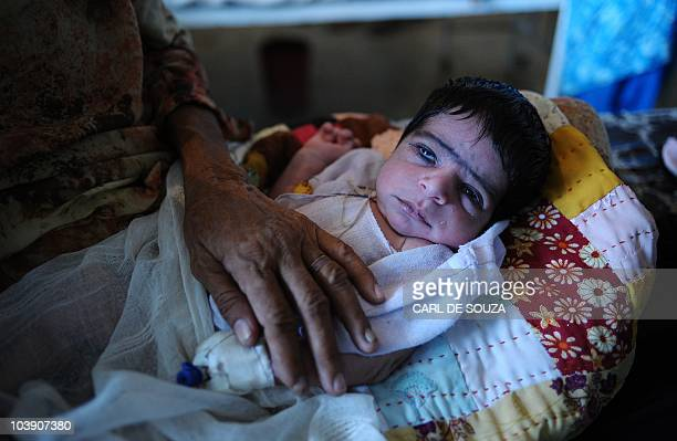A new born baby diagnosed with gastroenteritis lies on a bed at a hospital near Gehnay Wala Punjab Province Pakistan on September 4 2010 Hospitals...