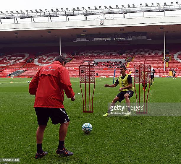 New boy Dejan Lovren of Liverpool in action during a training session at Anfield on August 8 2014 in Liverpool England
