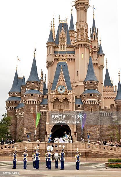 New bride bride Mayumi Kagoshi and her groom Takayuki Abiko enter the Cinderella castle for their wedding at the Tokyo Disneyland in Urayasu suburban...