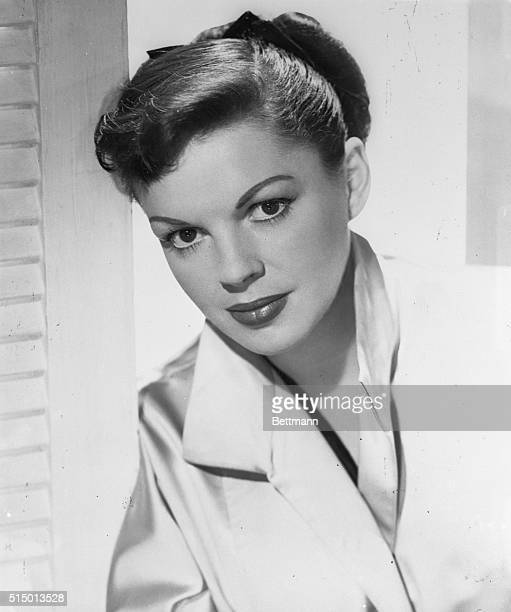 A new bride with a new hairdo and happier and sprightlier than ever is Judy Garland shown in the first informal portraits she has posed for in...