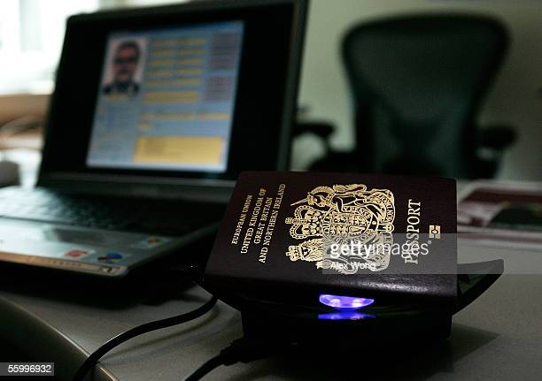 A new British biometric European Union passport which is embedded with a microchip sits on top of a reader during a news briefing at the British...