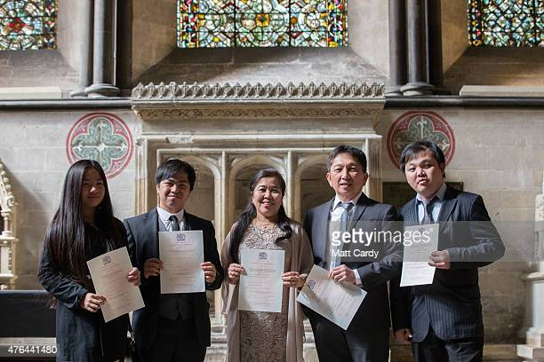 New British citizens gather for a photograph following a British citizenship ceremony in Salisbury Cathedral on June 9 2015 in Salisbury England The...