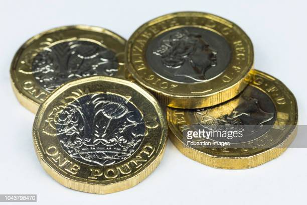 New British one pound coins isolated in white background.